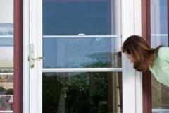 Woman Looking in Door - East Hanover, NJ - Lifetime Aluminum