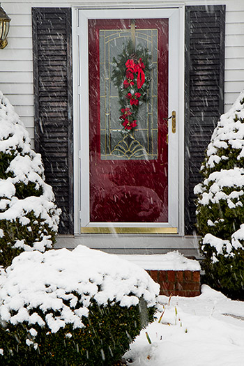 entrance to home with storm door