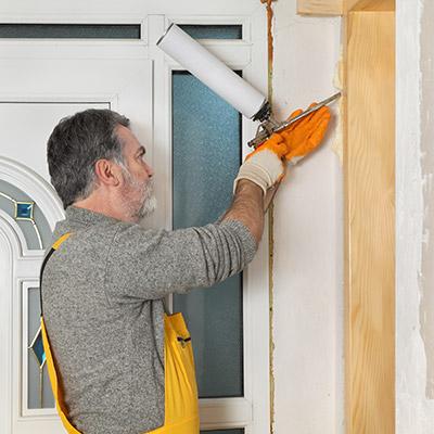 man installing door