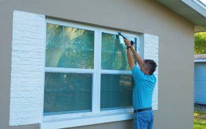 Technician Installing Storm Window
