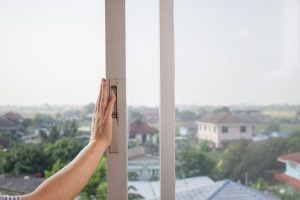 Woman's Hand Opening New Sliding Glass Window