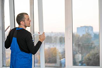 Technician installing a window